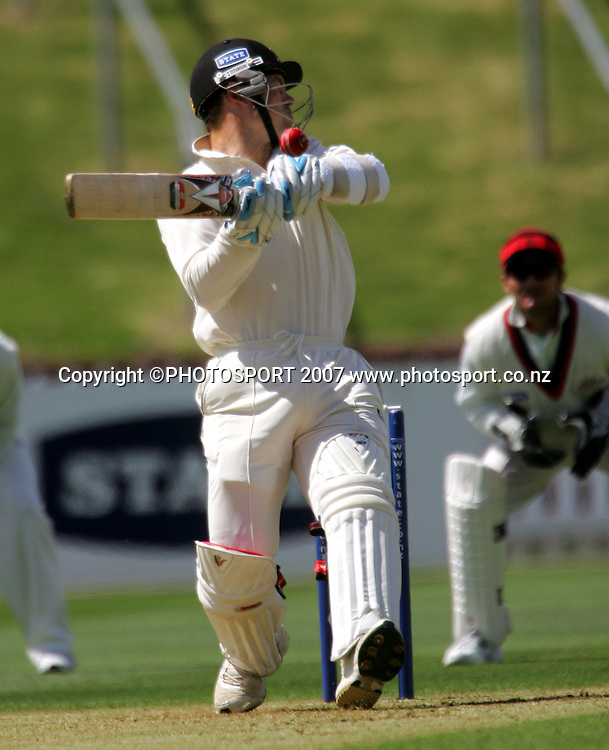 Willie Lonsdale's bouncer catches Matthew Bell's helmet.<br /> State Championship cricket match. Wellington Firebirds v Canterbury Wizards. Allied Prime Basin Reserve, Wellington. Wednesday 28 November 2007. Photo: Dave Lintott/PHOTOSPORT