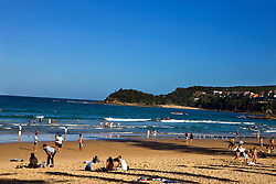 People on sand and shore, Manly Beach, New South Wales, Australia