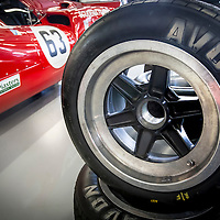 Stacked Avon Tyre in the foreground next to car #63, Lola T70 MK3B (1969), Marc Devis (BE) and Jonathan Kennard (GB), FIA Masters Historic Sports Cars, Silverstone Classic 2016, Silverstone Circuit, England. U.K.