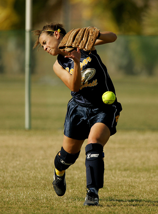 McAllen, TX / 2006 - Edinburg North high school center fielder Andrea Tressler (#4) struggles to catch a fly ball during early innings of a game against McAllen High at the Mission Fastpitch Softball Tournament at Westside Park. Photo by Mike Roy / The Monitor