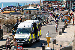 © Licensed to London News Pictures. 30/05/2020. Brighton, UK. Police officers patrol the beach in Brighton and hove as thousands of members of the public take to the seaside on the hottest day of the year so far.  Photo credit: Hugo Michiels/LNP