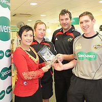 11/8/2008  IT'S a double win for Munster Rugby this year! Following the team?s Heineken Cup success, Munster Rugby has claimed the inaugural Specsavers' Fairplay League award for its exemplary disciplinary record within the Magners League. With indiscipline on the rugby pitch increasingly costing teams? vital points, the Specsavers Fairplay League celebrates good conduct on the field and Munster Rugby has topped the league for the club with the least disciplinary points for the 2007/08 season.  Presenting the award to Munsters Tony McGahan and Anthony Foley in Specsavers, Limerick on Monday was Sinead Clohessy, Director, Specsavers, Cruise's street, Limerick under the watchful eye of international referee George Clancy.<br /> Photograph: Liam Burke/Press 22 (with compliments)<br /> <br /> As the club with the fewest red and yellow cards or citings during 2007/08, Munster Rugby has been awarded ?13,000 by Specsavers, the official optical partner and referee sponsor for the Magners League. The ?13,000 will be used to fund development in junior clubs within the Munster region. Munster player Anthony Foley and new coach Tony McGahan were in their local Specsavers store in Cruises Street, Limerick, today, Monday 11 August to collect the coveted award from store director Sinead Clohessy.<br /> <br /> Under the watchful eye of referee George Clancy, Munster Rugby star Anthony Foley comments: ?It's fundamental to the future of rugby that teams recognise the importance of every match's referee. At Munster Rugby we acknowledge how vital referees are to the game, insuring fair play, and we believe as one of the competition?s leading clubs that we must strive to set the standard. We are thrilled to win this award and would like to thank Specsavers for the donation which will be put to help to coach Munster players of the future.?  <br /> <br /> Specsavers chairperson in Ireland Hugh Morris says: ?Rugby is a game of passion and I am delighted to reward Munster Rugby for showing 