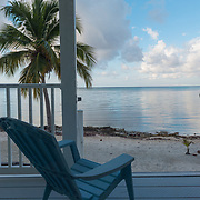 Chair on porch with a great view. East End. Grand Cayman Island.