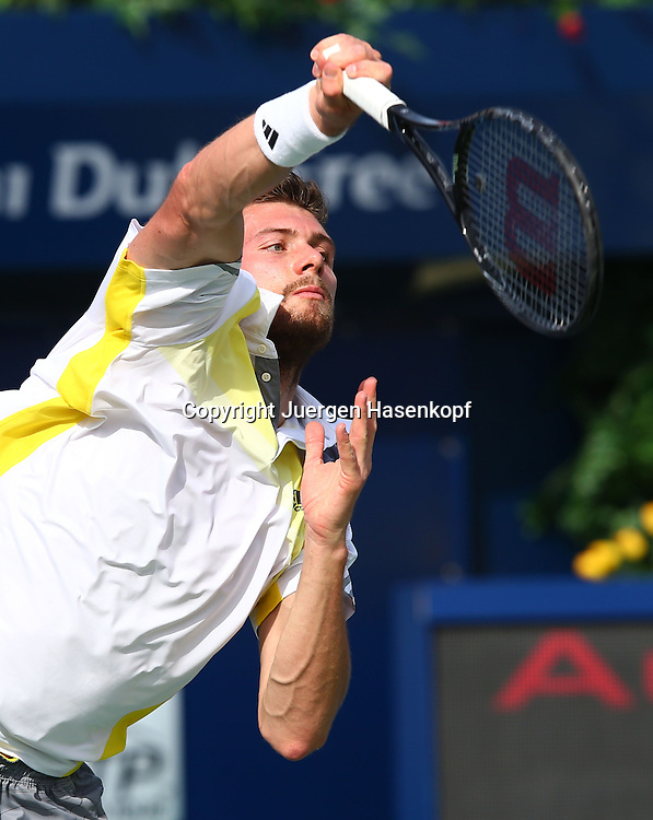 Dubai Tennis Championships 2013, ATP Tennis Turnier,International Series,Dubai Tennis Stadium, U.A.E., Daniel Brands (GER) Aktion,.Einzelbild,Halbkoerper,Hochformat,