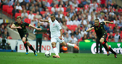 LONDON, ENGLAND - Saturday, June 2, 2012: England's Theo Walcott in action against Belgium during the International Friendly match at Wembley. (Pic by David Rawcliffe/Propaganda)