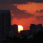 The sunsets onthe eclectic South Beach neighborhood of Miami Beach glitters with nightlife – all day long along its Art Deco hotels. People watching is a great pastime in this trendy and quirky area which draws celebrities and beautiful people from all over the world. Enjoy the beach or the historic Art Deco architecture or the fine Oceanside dining.    Photography by Jose More