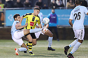 Braintree Town defender Kodi Lyons-Foster (16) attempts to get there ahead of Harrogate Town forward Jack Muldoon (18) during the Vanarama National League match between FC Halifax Town and Dover Athletic at the Shay, Halifax, United Kingdom on 17 November 2018.