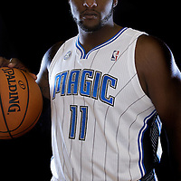 "Glen ""Big Baby"" Davis poses in front of a backdrop during the Orlando Magic media day event at the Amway Arena on Monday, September 30, 2103 in Orlando, Florida. (AP Photo/Alex Menendez)"