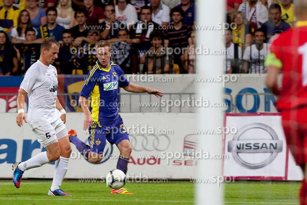 Jean-Philippe Caillet of F91 Dudelange and Robert Beric of NK Maribor during 3rd qualifying round for Champions League between NK Maribor (Slovenia) and F91 Dudelange (Luxembourg), on August 1, 2012, in Maribor, Slovenia. (Photo by Urban Urbanc / Sportida)