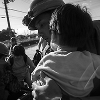 September 12, 2015 , Overflow  at Ibaraki near kinugawa river  , a japan self defense  soldier save  a child from flooding at Joso city. Pierre Boutier