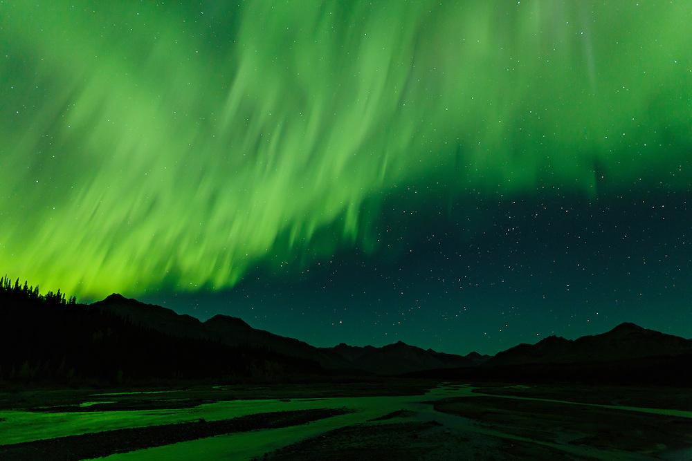 Aurora above Teklanika River in Denali National Park in Interior Alaska. Autumn. Evening.