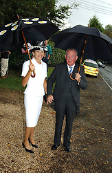 The EARL & COUNTESS OF HALIFAX at the wedding of Tom Parker Bowles to Sara Buys at St.Nicholas Church, Rotherfield Greys, Oxfordshire on 10th September 2005.<br />