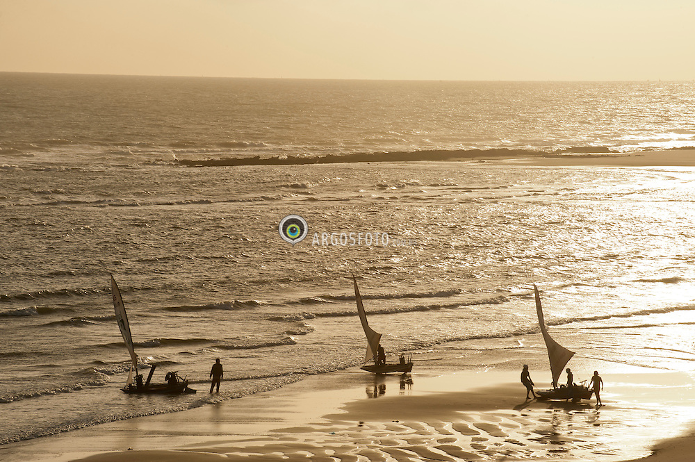 Jangadas ao por do sol na praia de Canoa Quebrada no  municipio de Aracati,  estado do Ceara./Rafts at sunset on the beach of Canoa Quebrada in the municipality of Aracati, state of Ceara.