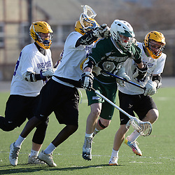 Staff photos by Tom Kelly IV<br /> Bonner-Prendie's Nick Saraceni (97) is sandwiched between Upper Darby defenders during the Upper Darby at Bonner-Prendie boys lacrosse game on Monday, March 23, 2015.