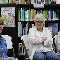 RAY VAN DUSEN/BUY AT PHOTOS.MONROECOUNTYJOURNAL.COM<br /> Charlotte Wathen, left, who is librarian at Wren and Hamilton's libraries, speaks during a public meeting about services provided during a community meeting in Wren last week. Both rural libraries could potentially face reduction in hours due to state budget cuts.