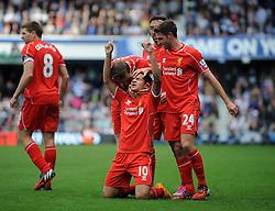 Liverpool's Philippe Coutinho celebrates his goal. - Photo mandatory by-line: Dougie Allward/JMP - Mobile: 07966 386802 - 19/10/2014 - SPORT - football - London - Loftus Road - QPR v Liverpool - Barclays Premier League