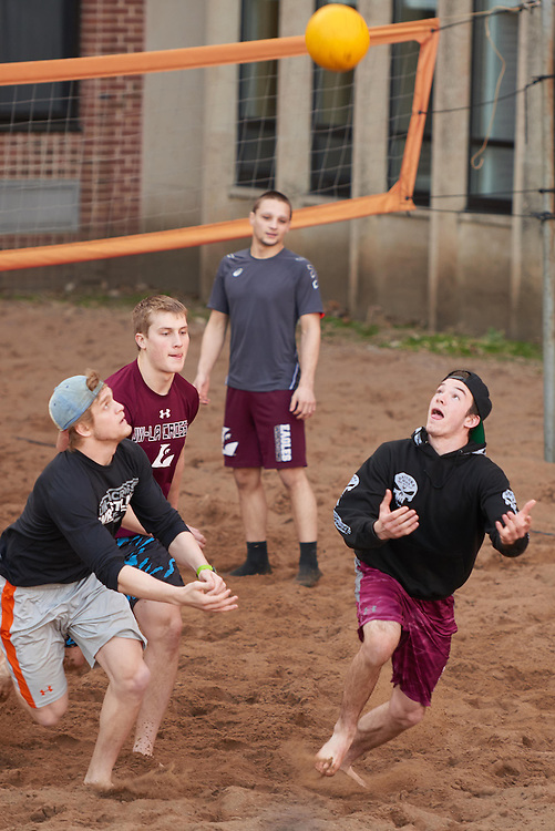 Activity; Playing; Relaxing; Socializing; Location; Outside; People; Student Students; UWL UW-L UW-La Crosse University of Wisconsin-La Crosse; Spring; March; Time/Weather; evening; Type of Photography; Candid; volleyball; Campus Life