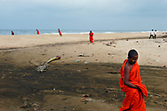 Buddhist monks stroll along the beaches of S.E. Sri Lanka, one of the areas hardest hit by the Tsunami caused by a 9.0 earthquake in the Indian Ocean on December 26th, 2004. Kalmunai, Ampara District, Sri Lanka. 12/01/2005. Photo © J.B. Russell