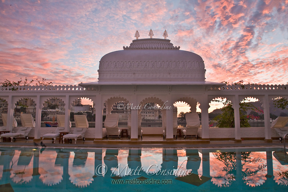 Dawn light reflection of marble arcade with carved columns and graceful arches in swimming pool of Taj Lake Palace.<br /> (Photo by Matt Considine - Images of Asia Collection)