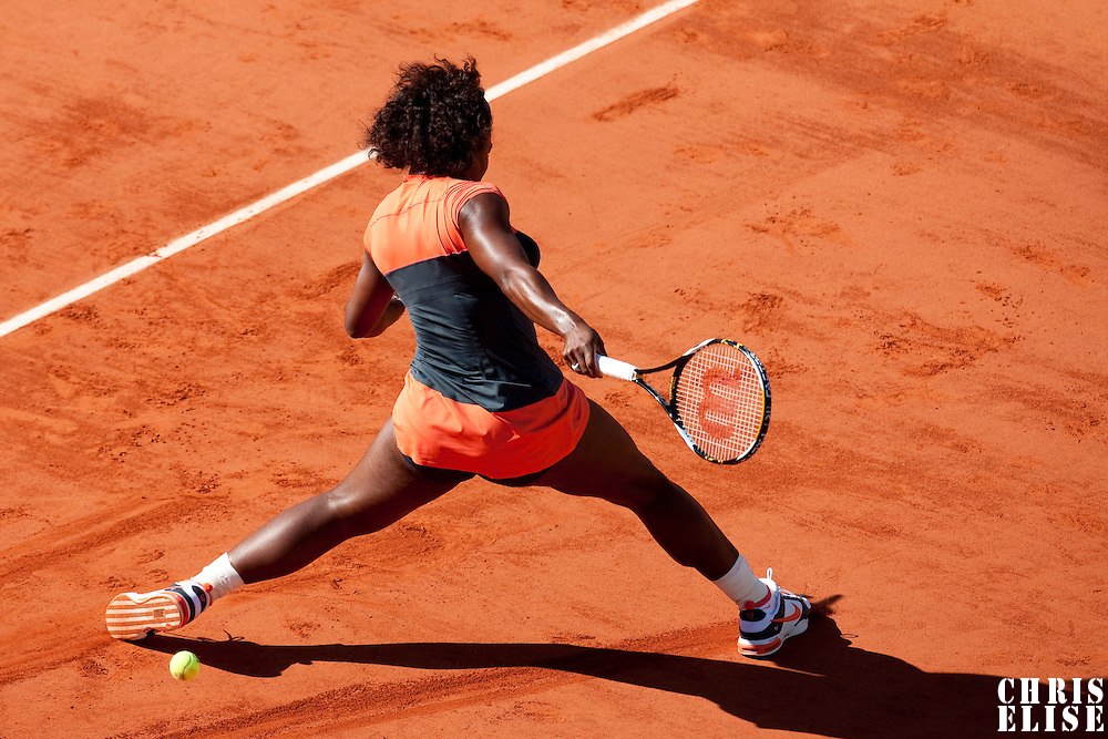 30 May 2009: Serena Williams of USA misses for a forehand as she stretches during the Women's Third Round match on day seven of the French Open at Roland Garros in Paris, France.