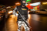 "05 FEBRUARY 2005 - NOGALES, SONORA, MEXICO: Members of ""Grupo Operativos"" a special operations unit of the Nogales, Sonora, Mexico, police department, on patrol in Nogales, Saturday night, Feb. 5. The Operativos specialize in anti-gang enforcement and drug interdiction missions. In recent months they have stepped up patrol activity in Nogales communities near the border. In January 2005, the US Department of State has issued a travel advisory advising US citizens to avoid travel along the US Mexican border because of increased violence, including the kidnapping of US citizens, in border communities. Most of the violence has been linked to the drug cartels, who are increasingly powerful in Mexico. The Operativos also patrol the districts of Nogales frequented by US tourists in an effort to prevent crime directed against US citizens.   PHOTO BY JACK KURTZ"