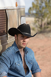 portrait of a cowboy outdoors on a ranch