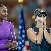 2019 US Open Tennis Tournament- Day Thirteen.   Winner Bianca Andreescu of Canada reacts at the trophy presentation watched by Serena Williams of the United States after the Women's Singles Final on Arthur Ashe Stadium during the 2019 US Open Tennis Tournament at the USTA Billie Jean King National Tennis Center on September 7th, 2019 in Flushing, Queens, New York City.  (Photo by Tim Clayton/Corbis via Getty Images)