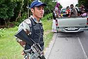 "28 SEPTEMBER 2009 -- TANJONG DATO, THAILAND:   A Thai security volunteer near the city of Yarang in Pattani, Thailand. Thailand's three southern most provinces; Yala, Pattani and Narathiwat are often called ""restive"" and a decades long Muslim insurgency has gained traction recently. Nearly 4,000 people have been killed since 2004. The three southern provinces are under emergency control and there are more than 60,000 Thai military, police and paramilitary militia forces trying to keep the peace battling insurgents who favor car bombs and assassination.   PHOTO BY JACK KURTZ"