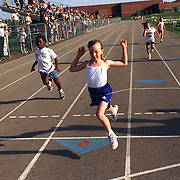 ....ankeny, may 12 -- Mackenzie Misel, 9 yrs. old, won her heat of the 100 meter dash in 16.75 at the Hershey's Track and Field Meet in Ankeny. Over 150 youth runners competed in the event. photo by david peterson