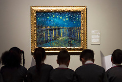 "© Licensed to London News Pictures. 25/03/2019. LONDON, UK. Pupils from Millbank Primary Academy view ""Starry Night"", 1888, by Vincent Van Gogh.  Preview of ""The EY: Van Gogh and Britain"" exhibition at Tate Britain, the first exhibition to look at the work of Vincent Van Gogh through his relationship with Britain and how he inspired British artists.  Over 50 of his works are on display 27 March to 11 August 2019.  Photo credit: Stephen Chung/LNP"