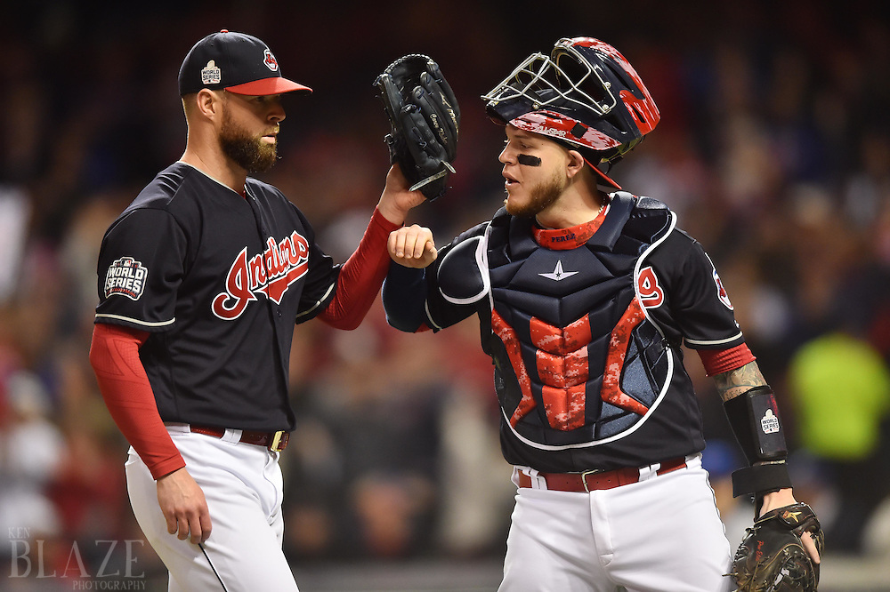 Oct 25, 2016; Cleveland, OH, USA; Cleveland Indians starting pitcher Corey Kluber (left) is greeted by catcher Roberto Perez after retiring the Chicago Cubs in the first inning in game one of the 2016 World Series at Progressive Field. Mandatory Credit: Ken Blaze-USA TODAY Sports