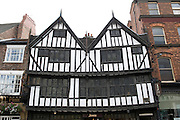 Large black and white Tudor building in Pavement, York, UK.  Today housing Jones the Bootmaker, this centuries-old building was the birthplace to Sir Thomas Herbert Bart, 1st Baronet as appointed by King Charles II. The plaque adorning the first storey of Herbert House tells us his birth date of 1606 and beneath is a snickelway leading to Lady Peckett's Yard. This street was named named in 1378  as it was  the first walkway to be paved in York out of all it's medieval streets.