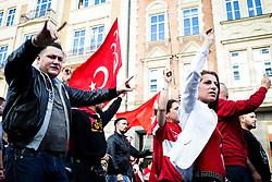 19.10.2014, Muenchen, GER, Aufmarsch von tuerkischen Nationalisten gegen die PKK, Der Rockerclub 'Turkos MC' rief zu einer Demonstration gegen die PKK auf. Laut Polizeiangaben hatte der Aufmarsch 200 Teilnehmer, weitere 50 Rocker fuhren auf Motorraedern vorneweg. Ein Grossteil der Teilnehmer trug Symboliken der nationalistischen 'Grauen Woelfe' und der MHP, viele zeigten immer wieder den sog. 'Wolfsgruss', im Bild Demoteilnehmer zeigen den sog. 'Wolfsgruss' der 'grauen Woelfe' // during a parade by Turkish nationalists against the PKK. Rockers of 'Turcos MC' called for a demonstration against the PKK. According to police, the march had 200 participants, another 50 Rocker went on motorcycles in front. A majority of the participants wore symbolism of the nationalist 'Grey Wolves' and the MHP, many showed again the so-called 'Wolf greeting', Munich, Germany on 2014/10/19. EXPA Pictures © 2014, PhotoCredit: EXPA/ Eibner-Pressefoto/ Gehrling<br /> <br /> *****ATTENTION - OUT of GER*****