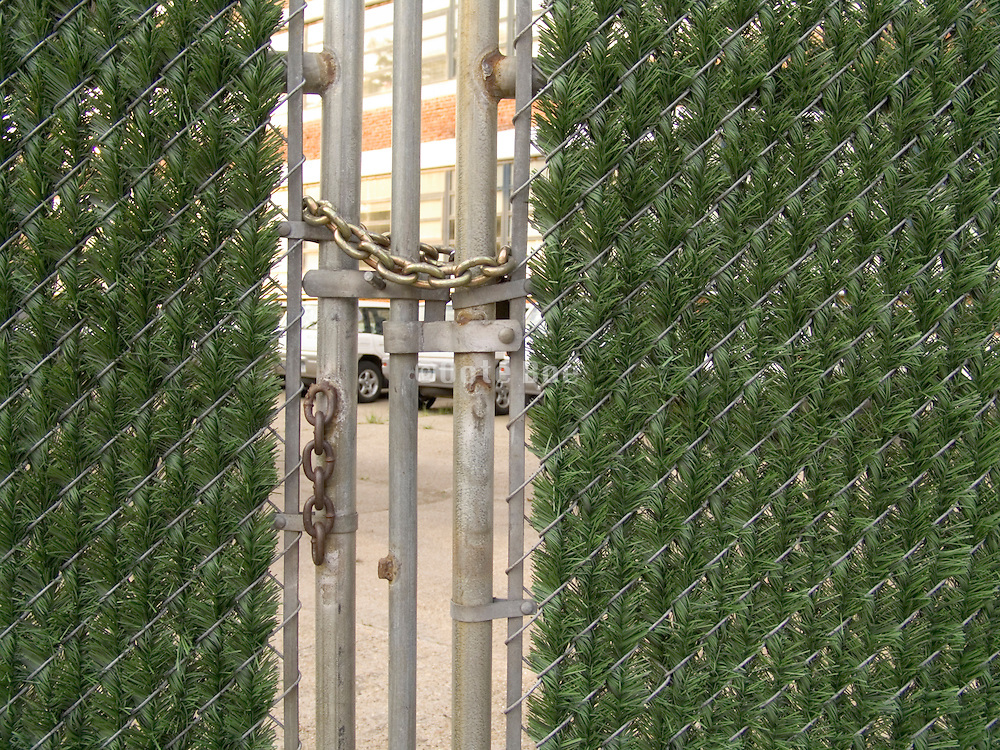 gate with fake green interwoven in fence