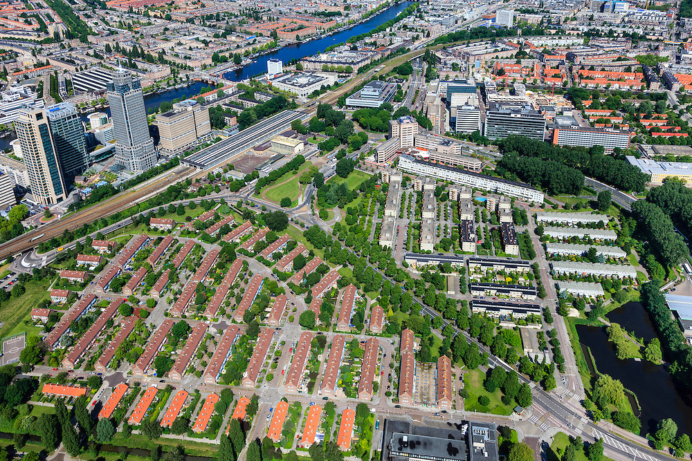 Nederland, Noord-Holland, Amsterdam, 14-06-2012; Watergraafsmeer, met links Amstelstation en links van het station bedrijventerrein de Omval met vlnr de Mondriaan toren, de Breitner toren (ook Philips toren ) en de Rembrandt toren. In de voorgrond - met rode daken - Amsteldorp..View on the residential district Watergraafsmeer in the east of Amsterdam with the head office of Philips in the high rise building of business park (left)..luchtfoto (toeslag), aerial photo (additional fee required).foto/photo Siebe Swart