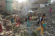 Nepali children return home after a day at school. Daily life tries to return to normal after the immense devastation of the April 2015 earthquake in Nepal