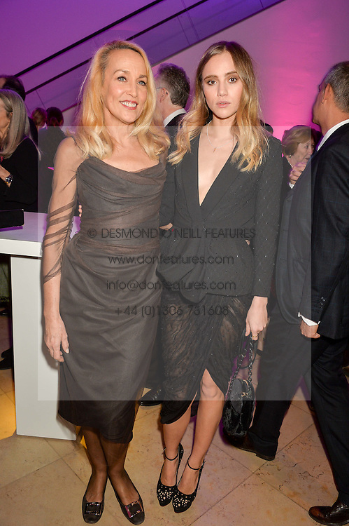Left to right, JERRY HALL and SUKI WATERHOUSE at the Alexandra Shulman and Leon Max hosted opening of Vogue 100: A Century of Style at The National Portrait Gallery, London on 9th February 2016.