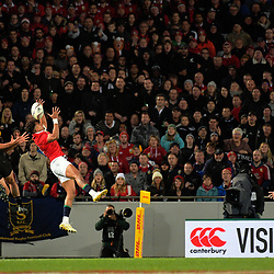 Anthony Watson beats Codie Taylor to a cross kick during the 2017 DHL Lions Series rugby union match between the NZ All Blacks and British & Irish Lions at Eden Park in Auckland, New Zealand on Saturday, 24 June 2017. Photo: Dave Lintott / lintottphoto.co.nz