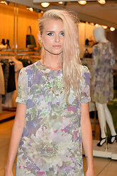 Singer-songwriter KYLA LA GRANGE at the French Connection #NeverMissATrick Launch Party held at French Connection, 396 Oxford Street, London on 23rd July 2014.