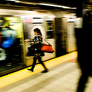 A woman gets on the train at the Port Authority subway station in New York, February 19, 2010.