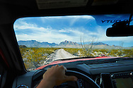 Driving a back country dirt road in Big Bend National Park, Texas.