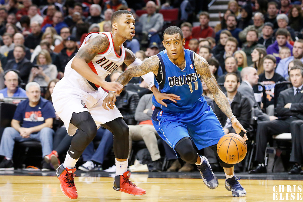 07 December 2013: Dallas Mavericks shooting guard Monta Ellis (11) drives past Portland Trail Blazers point guard Damian Lillard (0) during the Dallas Mavericks 108-106 victory over the Portland Trail Blazers at the Moda Center, Portland, Oregon, USA.