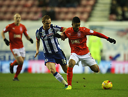 Elias Kachunga of Huddersfield Town (R) and Shaun MacDonald of Wigan Athletic in action - Mandatory by-line: Jack Phillips/JMP - 02/01/2017 - FOOTBALL - DW Stadium - Wigan, England - Wigan Athletic v Huddersfield Town - Football League Championship