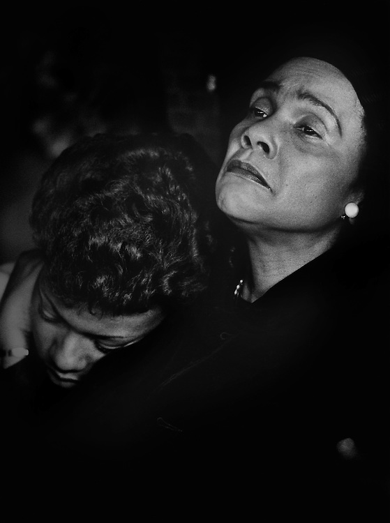 """Coretta Scott King, widow of the slain civil rights leader Dr. Martin Luther King, Jr., comforts her daughter as they attend the funeral of Dr. Martin Luther """"Daddy"""" King, Sr. at King's Ebenezer Baptist Church in Atlanta, Georgia."""