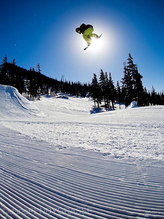 Professional snowboarder Dave Fortin catches air in the Terrain Park on Blackcomb Mountain, British Columbia, Canada