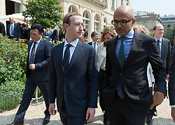 """Mark Zuckerberg and Satya Nadella doing a family picture during the """"Tech for Good"""" summit over lunch with tech companies CEOs at the Elysee Palace, Paris, France, on May 23, 2018. Photo by Jacques Witt/pool/ABACAPRESS.COM"""