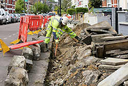 © Licensed to London News Pictures. 11/05/2020. London, UK. A construction worker digs the pavement in north London to replace slabs. Prime Minister Boris Johnson in his televised address to the nation from Downing Street has urged construction workers to return to work as he announced a very limited relaxation of the lockdown measures imposed in March to fight the coronavirus. Photo credit: Dinendra Haria/LNP