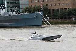 © Licensed to London News Pictures. 05/09/2016. LONDON, UK.  Bladerunner passing HMS Belfast on the River Thames. The Royal Navy test out Bladerunner, their new prototype high speed drone speedboat on the River Thames in London this afternoon ahead of a major exercise. It is part of the Royal Navy's Unmanned Arrior program, which seeks to find an edge in the field of naval combat.  Photo credit: Vickie Flores/LNP