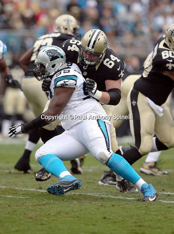 Carolina Panthers defensive tackle Kawann Short (99) is blocked by New Orleans Saints tackle Zach Strief (64) as he rushes during the 2015 NFL week 3 regular season football game against the New Orleans Saints on Sunday, Sept. 27, 2015 in Charlotte, N.C. The Panthers won the game 27-22. (©Paul Anthony Spinelli)