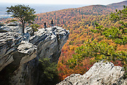 "Look across miles of autumn orange and red foliage at Hanging Rock State Park, Stokes County, North Carolina, USA. The eroded quartzite knob called Hanging Rock rises to 2150 feet elevation. The park is 30 miles (48 km) north of Winston-Salem, and approximately 2 miles (3.2 km) from Danbury. Hanging Rock State Park is located in the Sauratown Mountain Range, which is made up of monadnocks (or inselbergs, isolated hills) that are separated from the nearby Blue Ridge Mountains. Prominent peaks in the Sauratown range rise from 1,700 feet (520 m) to more than 2,500 feet (760 m) in elevation and stand in contrast to the surrounding countryside, which averages only 800 feet (240 m) in elevation. Named for the Saura Native Americans who were early inhabitants of the region, the Sauratown Mountains are the erosion-resistant quartzite remnants of mountains pushed up between 250 and 500 million years ago. Published in ""Light Travel: Photography on the Go"" book by Tom Dempsey 2009, 2010."